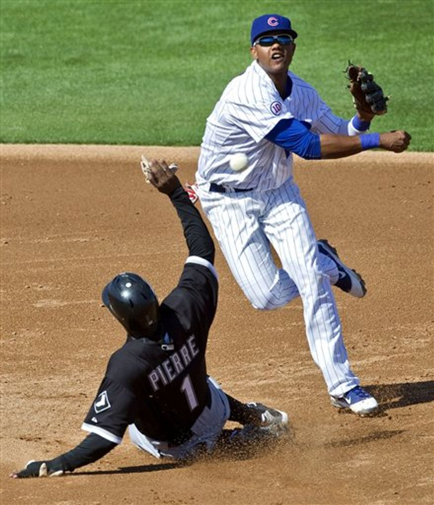 Chicago Cubs' Starlin Castro forces out Chicago White Sox Juan Pierre (1) during the third inning of a spring training baseball game Thursday, March 24, 2011, at HoHoKam Park in Mesa, Ariz. (AP Photo/Matt York)