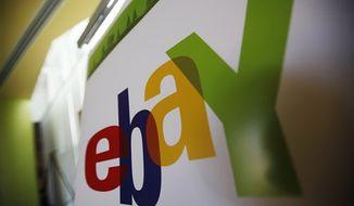 In this Feb. 24, 2010 file photo, an eBay logo is seen at their offices in San Jose, Calif. (AP Photo/Paul Sakuma, File) **FILE**