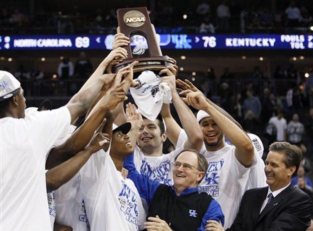 Kentucky's Brandon Knight cuts down the net after the NCAA men's college basketball tournament East regional final against North Carolina, Sunday, March 27, 2011, in Newark, N.J. Kentucky won 76-69. (AP Photo/Julio Cortez)