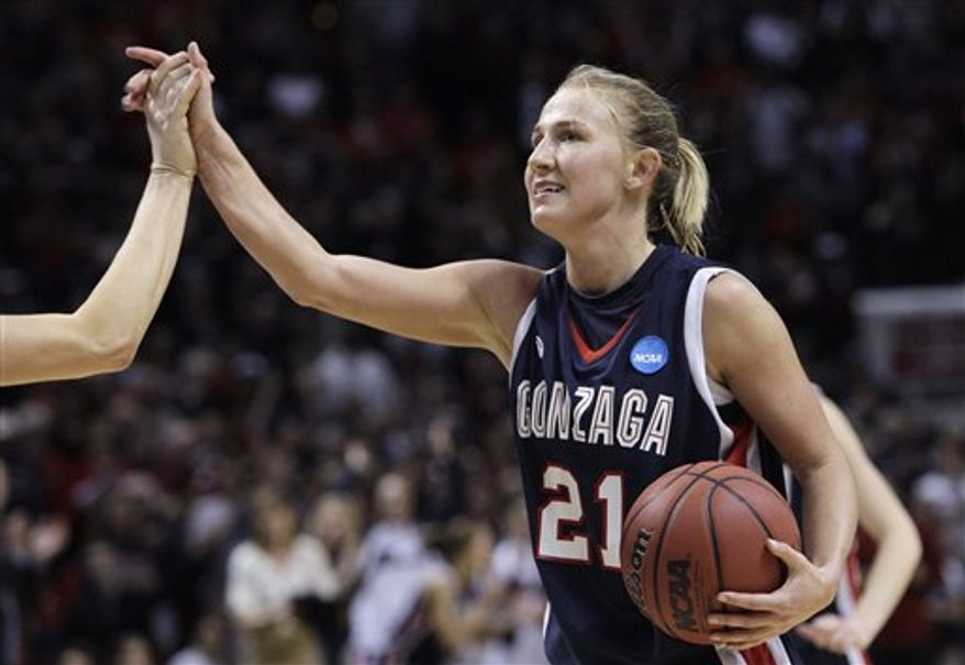 Gonzaga's Courtney Vandersloot races upcourt against Louisville as Katelan Redmon follows in the second half of an NCAA women's college basketball tournament regional semifinal, Saturday, March 26, 2011, in Spokane, Wash. Gonzaga won 76-69. (AP Photo/Elaine Thompson)