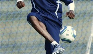 FILE - This March 23, 2011, file photo shows NFL star Chad Ochocinco kicking around the ball during a tryout with Sporting Kansas City MLS soccer team, , in Kansas City, Mo. Since there's no telling when the NFL lockout will end, guys are finding all sorts of ways to keep busy.  (AP Photo/Ed Zurga, File)