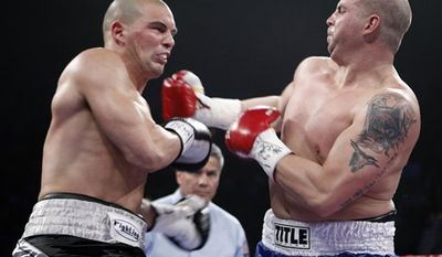 This photo made March 12, 2011 shows Tommy Zbikowski, left, a safety for the Baltimore Ravens NFL team, trading punches with Richard Bryant, during their heavyweight boxing match at The MGM Grand Garden Arena in Las Vegas. Since there's no telling when the NFL lockout will end, guys are finding all sorts of ways to keep busy. (AP Photo/Eric Jamison)