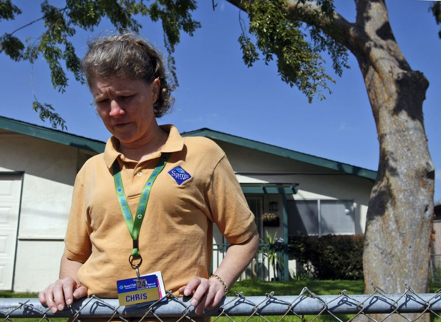 Christine Kwapnoski of Bay Point, Calif., an assistant manager at Sam's Club in Concord, Calif., is one of the named plaintiffs in a class-action sex discrimination suit against Wal-Mart over pay and promotions. If the Supreme Court approves, it would be the largest class action in U.S. history, affecting some 1.5 million people. (AP Photo)
