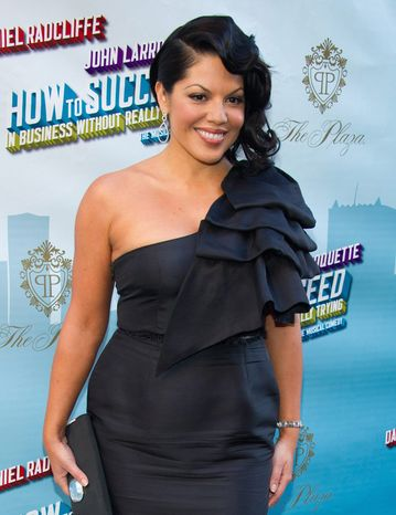 """Sara Ramirez and """"Grey's Anatomy"""" cast mates sing on """"The Musical Event"""" episode. (Associated Press)"""