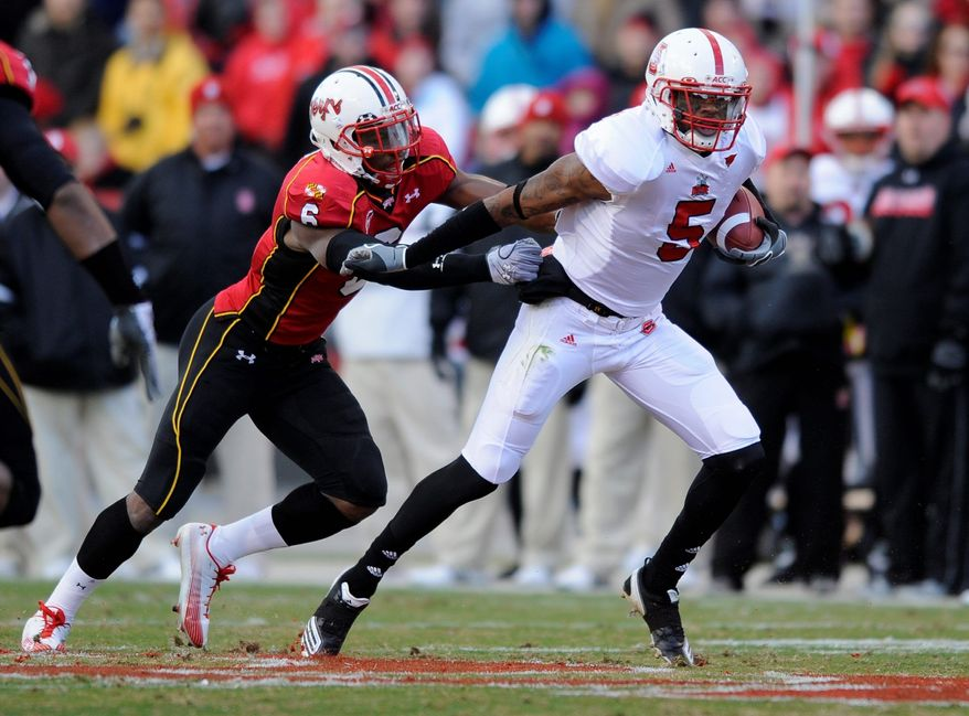 Maryland defensive back Kenny Tate (6) reaches for North Carolina State wide receiver Jarvis Williams (5) in a game at College Park last season. Tate is shifting to a safety-linebacker hybrid position for Maryland next season under new coach Randy Edsall. (Associated Press)
