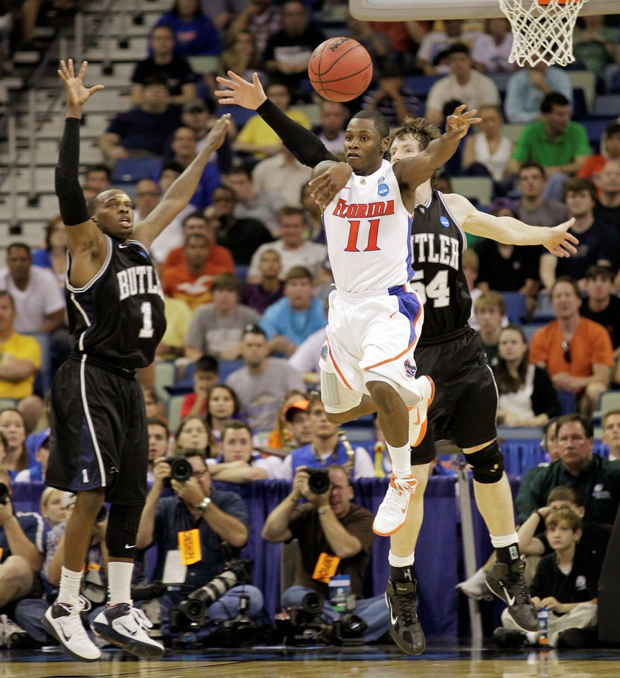 Florida guard Erving Walker (11) has the ball knocked away by Butler forward Matt Howard (54) as Butler guard Shelvin Mack (1) looks on during the second half of the NCAA Southeast regional college basketball championship game on Saturday in New Orleans. Butler defeated Florida 74-71. (Associated Press)