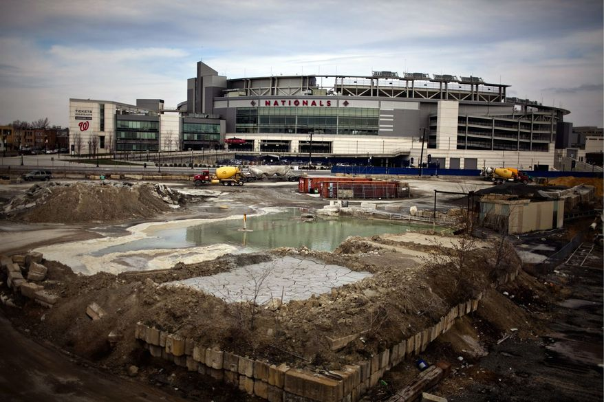WORK IN PROGRESS: The Washington Nationals' fourth Opening Day at Nationals Stadium is Thursday, but fans still don't have a vibrant neighborhood along Half Street Southeast where they can enjoy dinner, drinks or shopping. (Drew Angerer/The Washington Times)
