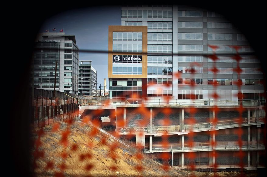 Construction near Half Street Southeast can be seen near the center field entrance of Nationals Park. Monument Realty is the primary developer along the street. (Drew Angerer/The Washington Times)