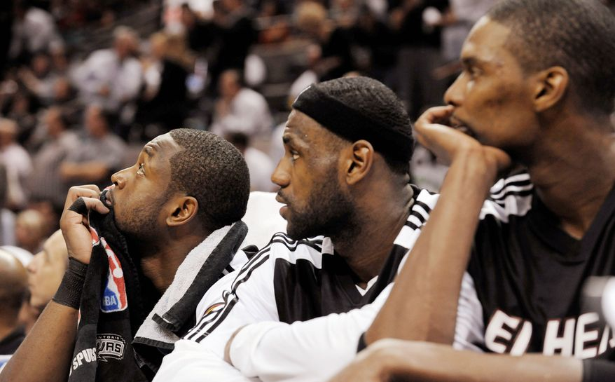 The Miami Heat's Dwyane Wade, LeBron James and Chris Bosh watch from the bench in a game against the San Antonio Spurs. Wizards owner Ted Leonsis is quick to remind fans that while the free-agent formula chosen by the Heat may be a quick fix, it rarely works for long-term success. (Associated Press)