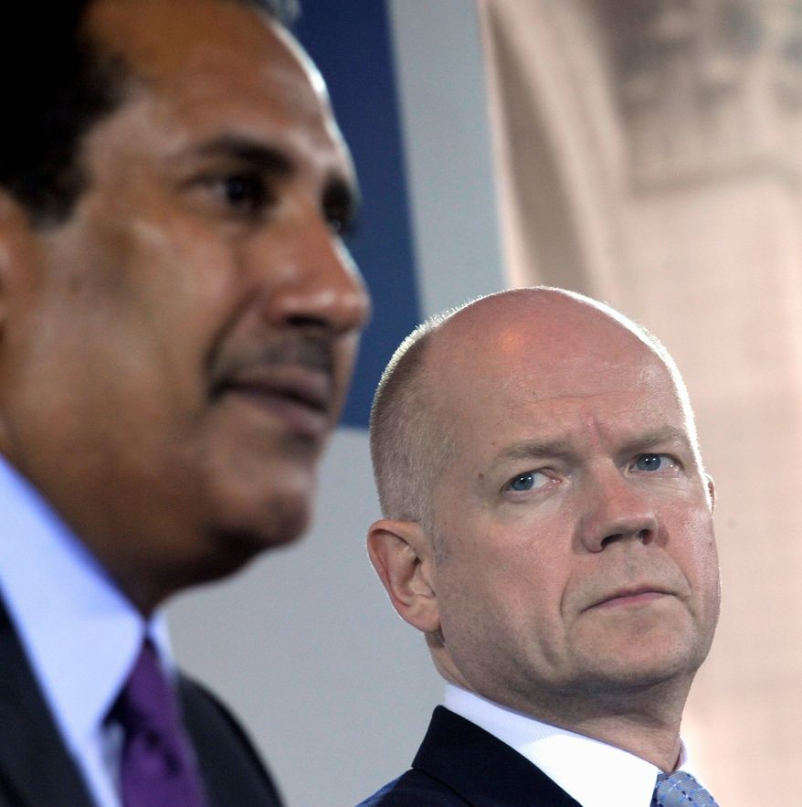 """Britain's Foreign Secretary William Hague (right), listening to Qatar's Sheikh Hamad bin Jassim al-Thani, said after Tuesday's London Conference on Libya the subject of arming rebels did not come up. """"That was not one of the subjects for discussion,"""" he said. (Associated Press)"""