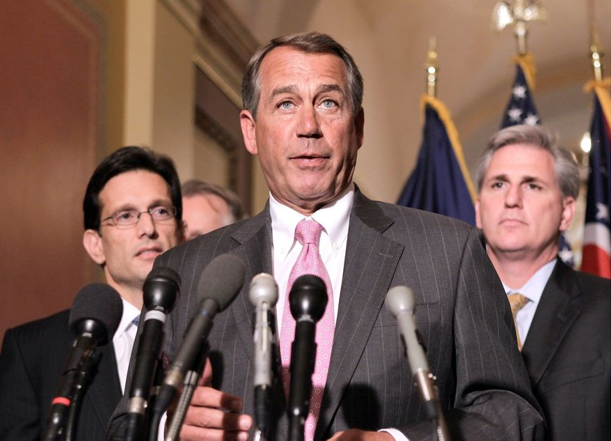 House Speaker John A. Boehner (center) of Ohio is flanked by fellow Republicans House Majority Leader Eric Cantor of Virginia (left) and House Majority Whip Kevin McCarthy of California as he speaks to reporters on Capitol Hill on Tuesday. Mr. Boehner chided Democrats over the budget impasse. (Associated Press)
