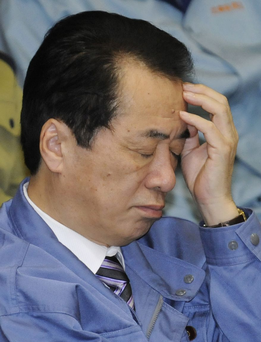 **FILE** Japanese Prime Minister Naoto Kan, wearing one of the blue work jackets that have become ubiquitous among bureaucrats since the tsunami, reacts during a budget committee meeting in parliament's upper house in Tokyo on March 29, 2011. (Associated Press)