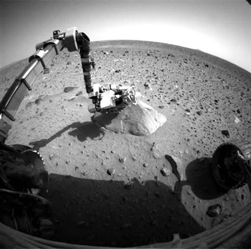 FILE - This undated file image provided by NASA shows the surface of Mars as seen from the stuck Mars rover, Spirit. The prospect of ever hearing from Spirit is fading after it failed to respond to repeated calls from Earth since a little over a year ago. NASA officials say the fact that Spirit hasn't called home suggests something is more seriously wrong than just a power issue. (AP Photo/NASA, File)