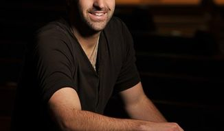 In this Feb. 8, 2011 photo, singer-songwriter Josh Kelley poses for photos at the Ryman Auditorium in Nashville, Tenn. (AP Photo/Donn Jones)