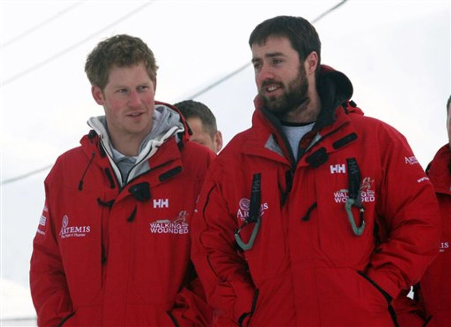 Britain's Prince Harry reacts as he tries out an immersion suit, during training for the Walking with the Wounded expedition, on the island of Spitsbergen, situated between the Norwegian mainland and the North Pole, Wednesday March 30, 2011. The third in line to the British throne will train for three days before accompanying the team on the first five days of their four-week expedition. (AP Photo/ David Cheskin, Pool)
