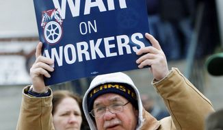 Larry Cerne, of Cleveland, protests against Senate Bill 5 at the Ohio Statehouse on Tuesday in Columbus. The bill would strip public employees of most collective-bargaining rights. Ohio's governor has said he would sign the measure. (Associated Press)