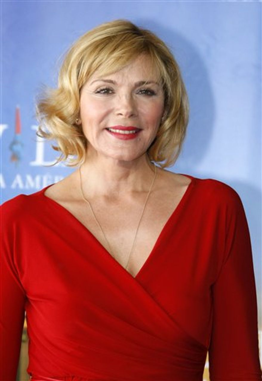 "FILE - In this Sept. 11, 2010 file photo, U.S. actress Kim Cattrall from the film "" Meet Monica Velour"" poses for photographers at the 36th American Film Festival in Deauville, Normandy, France. Cattrall plays a aging adult film star and a single mother in the film. (AP Photo/Michel Spingler, file)"