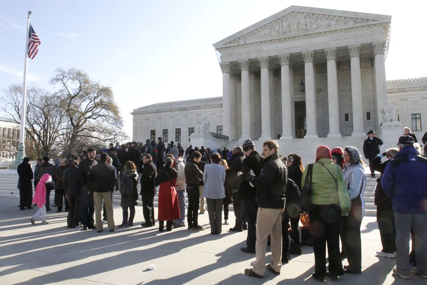 People line up outside the U.S. Supreme Court in Washington on Tuesday, March 29, 2011, to attend a hearing in a class-action suit by female employees of Wal-Mart. (AP Photo/Jacquelyn Martin)