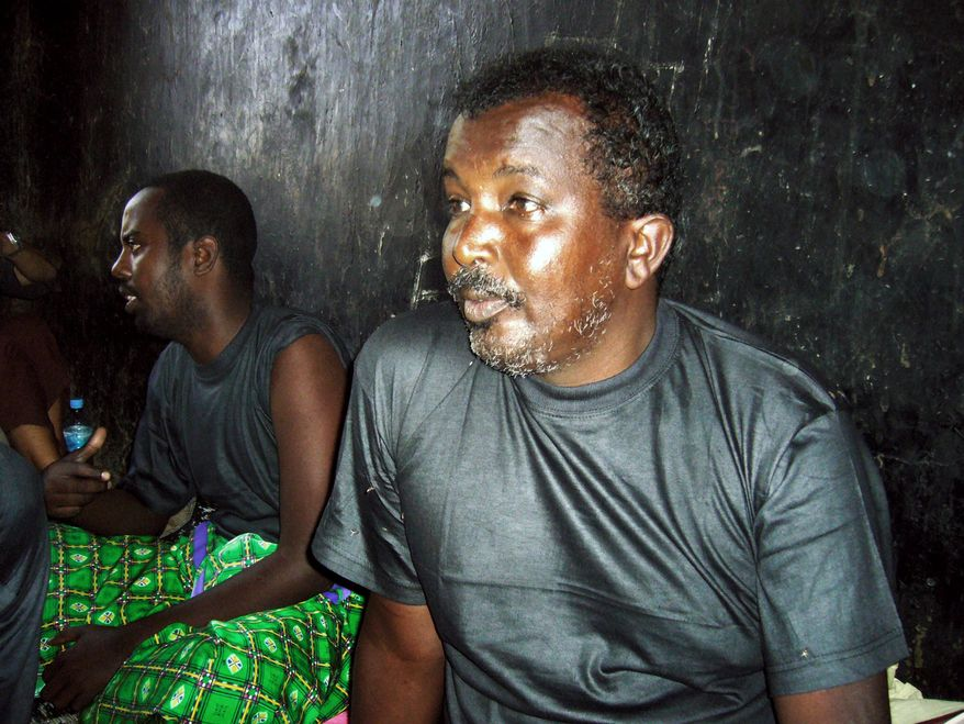 """Omar Abdullahi Abdi sits in a prison in the Somaliland port city of Berbera. He claims he is a fisherman but the Somaliland coast guard accuse him of being a pirate. """"I'm innocent. We are all innocent,"""" he said, referring to the others who were arrested. (Associated Press)"""
