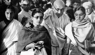 ** FILE ** Mahatma Gandhi is seen in 1948 with two of his disciples. A state in western India has banned author Joseph Lelyveld's new book, which some reports have said indicates Gandhi had a gay lover. (Associated Press)
