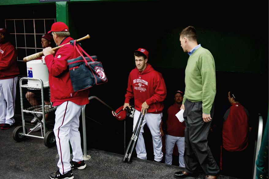Bryce Harper (center), the Nationals' top rookie prospect, takes the field for an open practice during NatsFest in Washington on Wednesday. (Drew Angerer/The Washington Times)