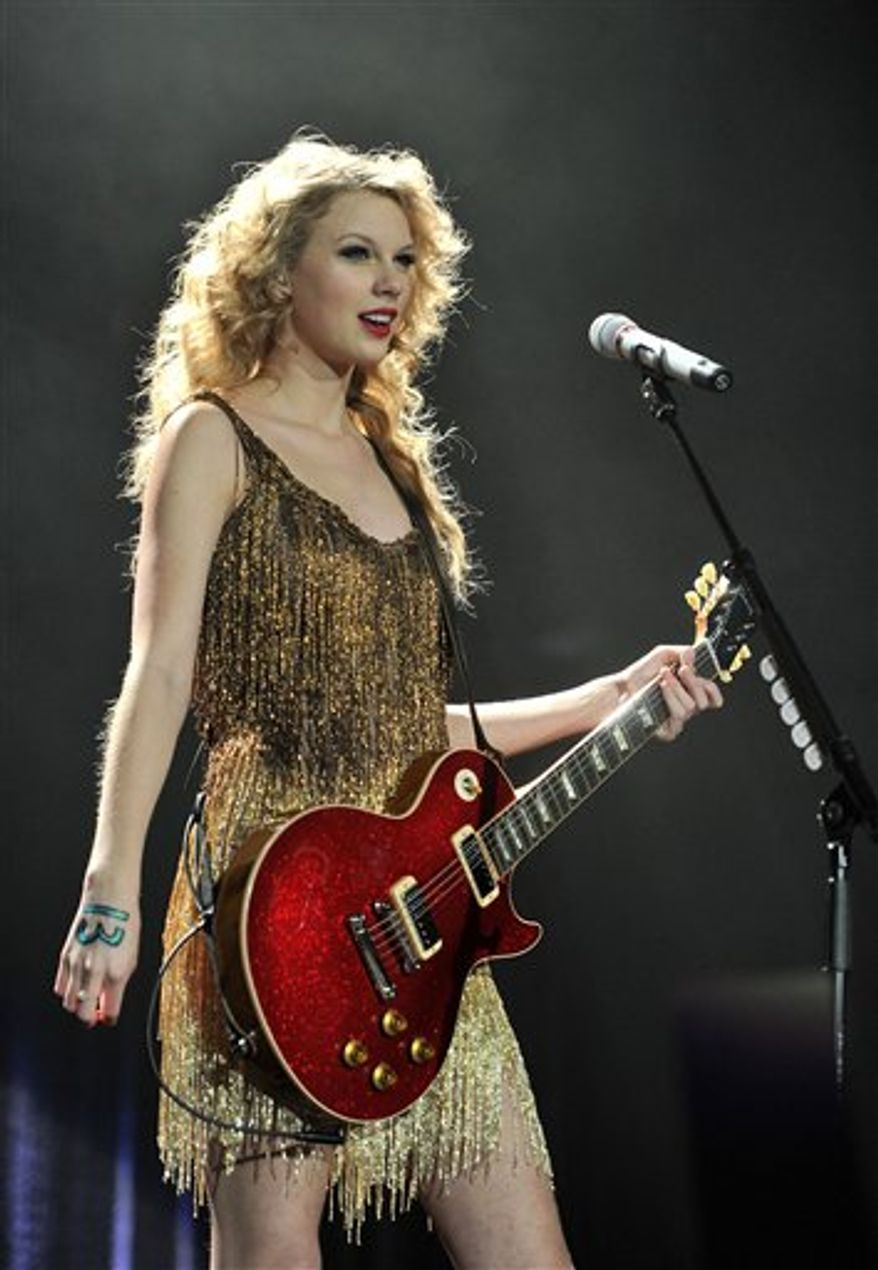 US singer Taylor Swift performs on the last night of her European Tour at London's O2 Arena on Wednesday March 30, 2011. (AP Photo/Mark Allan)