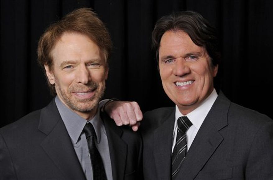 """Jerry Bruckheimer, left, producer of the upcoming Disney film """"Pirates of the Caribbean: On Stranger Tides,"""" poses with the film's director Rob Marshall backstage at CinemaCon 2011, Tuesday, March 29, 2011, in Las Vegas. (AP Photo/Chris Pizzello)"""
