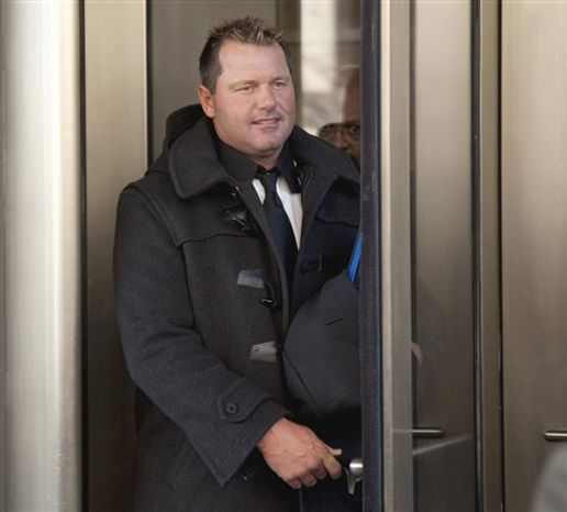 FILE - In this Feb. 2, 2011 file photo, former Major League Baseball pitcher Roger Clemens leaves federal court in Washington. Clemens says he's eager to defend himself in federal court this summer. The seven-time Cy Young winner says prosecutors have damaged the reputations of others as they've tried to prove that he lied to a congressional committee about alleged steroid use.  (AP Photo/Evan Vucci, File)
