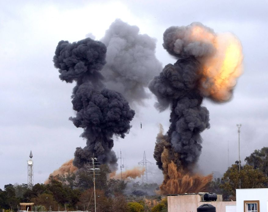 In this photo released by China's Xinhua news agency, heavy smoke rises over the Tajoura area, some 30 km east of Tripoli, Libya, after an airstrike on Tuesday, March 29, 2011. (Xinhua/Hamza Turkia)