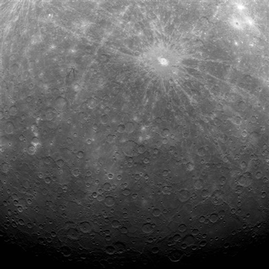 This image provided by NASA is the first ever obtained from a spacecraft in orbit about the Solar System's innermost planet, Mercury. The image was captured early this morning, at 5:20 a.m. EDT,Tuesday March 29, 2011. The dominant rayed crater in the upper portion of the image is Debussy. The bottom portion of this image is near Mercury's south pole and includes a region of Mercury's surface not previously seen by spacecraft. On March 17, 2011 (March 18, 2011, UTC), MESSENGER became the first spacecraft to orbit the planet Mercury.  (AP Photo/NASA)