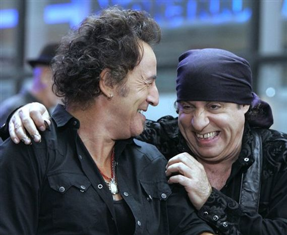 """FILE - In this Sept. 28, 2007 file photo, Bruce Springsteen, left, and band member Steven Van Zandt get together between songs when they appeared on the NBC """"Today"""" television program in New York's Rockefeller Center. With old friend Springsteen stopping by to swap music stories for the ninth anniversary of Van Zandt's rock radio show, Van Zandt laughed at the notion that he'd set the bar pretty high for the tenth year. """"It's been an open invitation,"""" said Van Zandt, guitarist in Springsteen's E Street Band. """"He just finally got around to it."""" (AP Photo/Richard Drew, File)"""