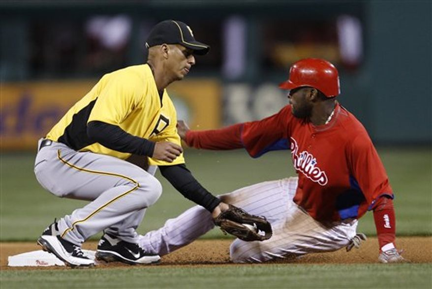 Pittsburgh Pirates' Pedro Alvarez, right, is greeted by teammates in the dugout after hitting a two-run home run off Philadelphia Phillies starting pitcher Cole Hamels in the second inning of an exhibition baseball game on Wednesday, March 30, 2011, in Philadelphia. (AP Photo/Matt Slocum)