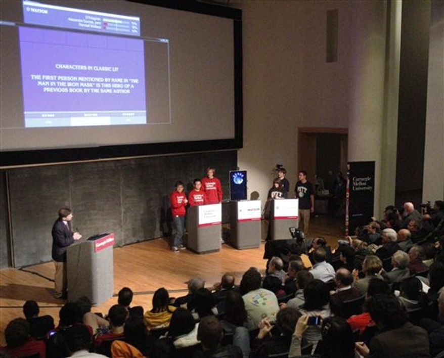 Eric Brown, left, a researcher for IBM, hosts a version of the television game show Jeopardy! between IBM's Watson computer and students from Carnegie Mellon University and the University of Pittsburgh during a symposium on Watson, at Carnegie Mellon University in Pittsburgh, Wednesday, March 30, 2011.  Watson is the question-answering IBM computer that made headlines by competing against humans on the actual television game show.  (AP Photo/Keith Srakocic)