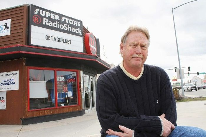 Steve Strand, who owns a RadioShack outlet in Hamilton, Mont., says he will defy RadioShack corporate officials' insistence that he halt a free-gun promotion with satellite television subscriptions, in effect since October. (Associated Press)