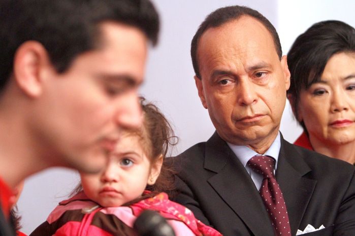 """Democratic Reps. Luis V. Gutierrez of Illinois (second from right) and Judy Chu of California (right), and Melisa Arellanos, 2, of Hyattsville, a U.S. citizen whose mother is facing deportation, listen during a Capitol Hill news conference on Thursday to launch the """"Campaign for American Children and Families"""" tour. (Associated Press)"""