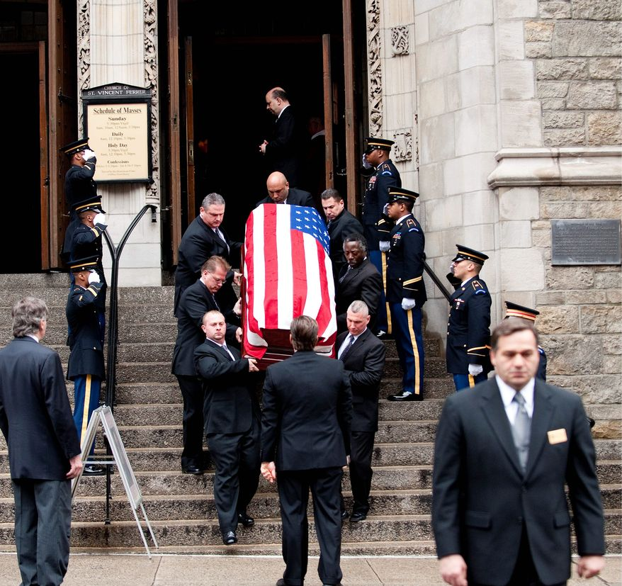 Former vice-presidential candidate Geraldine Ferraro's casket is carried out of the Church of Saint Vincent Ferrer later Thursday. Mrs. Ferraro, 75, died Saturday of multiple myeloma, a form of blood cancer. (Associated Press)