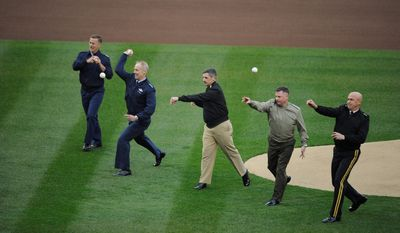 From left, Rear Adm. Paul Zukunft of the Coast Guard, Lt. Gen. Richard Y. Newton III of the Air Force, Vice Adm. Michael Vitale of the Navy, Lt. Gen. Terry G. Robling of the Marine Corps, and Maj. Gen. Karl Horst of the Army throw out first pitches Thursday. (Rod Lamkey Jr./The Washington Times)