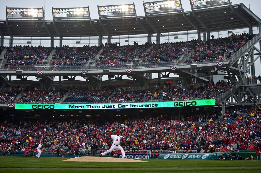 Nationals starter Livan Hernandez throws the first pitch of the season in the team's home opener Thursday. (Drew Angerer/The Washington Times)