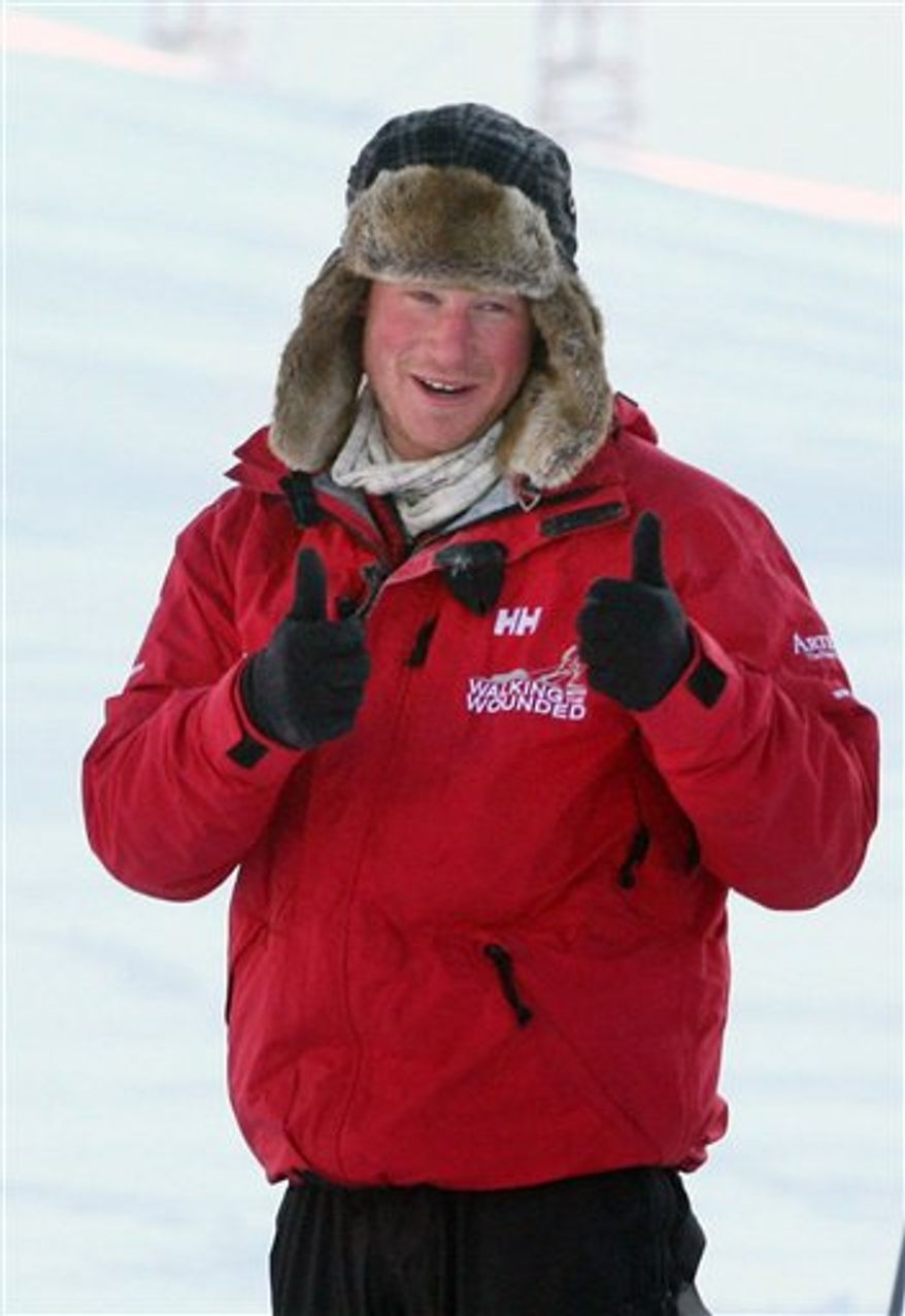 Britain's Prince Harry, gestures, during training for the Walking with the Wounded expedition, on the island of Spitsbergen, situated between the Norwegian mainland and the North Pole, Thursday March 31, 2011. The third in line to the British throne will train for three days before accompanying the team on the first five days of their four-week expedition. (AP Photo/David Cheskin, Pool)