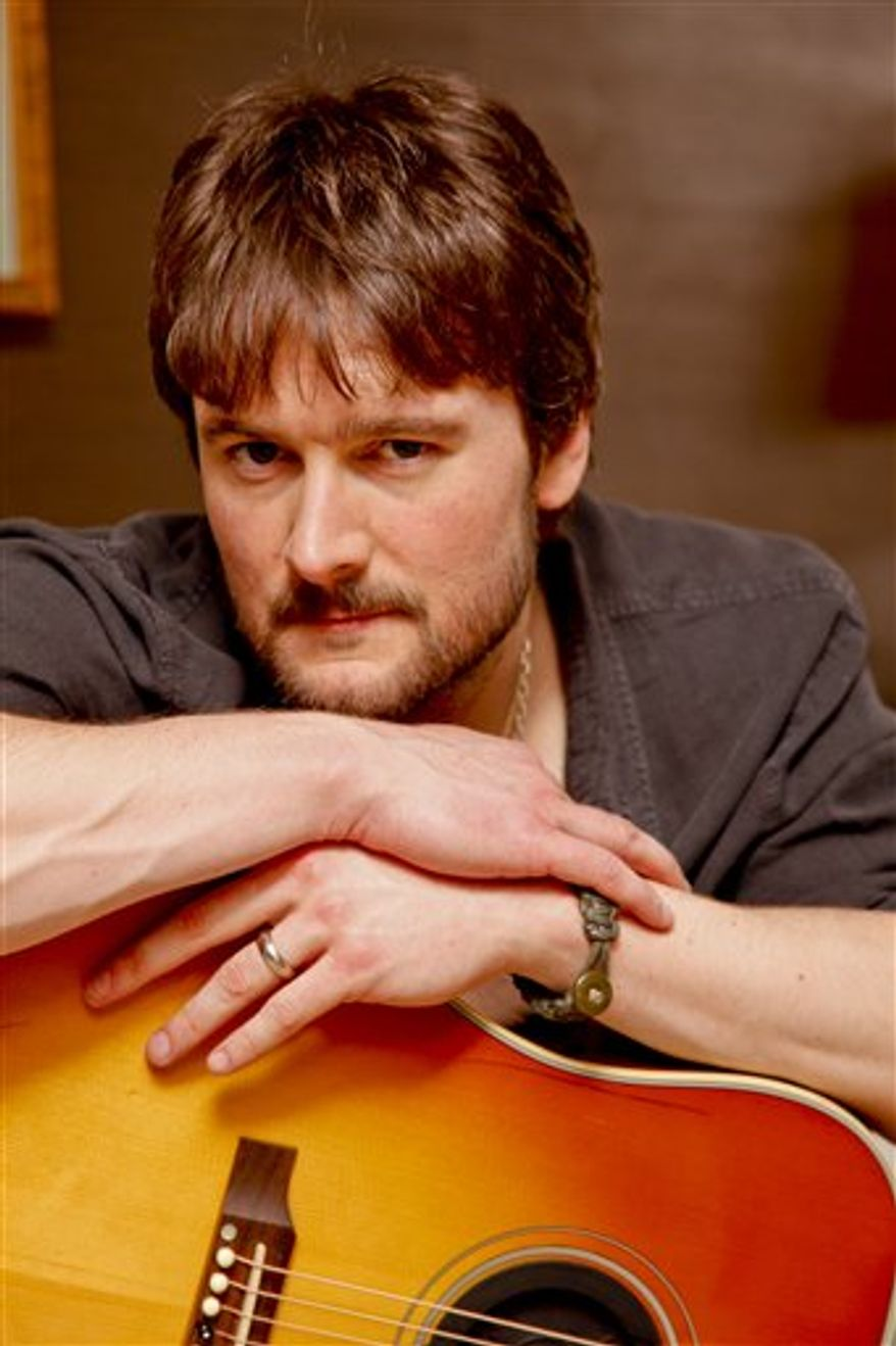 In this March 18, 2011 photo, country singer Eric Church performs at the Grand Ole Opry in Nashville, Tenn. (AP Photo/Ed Rode)