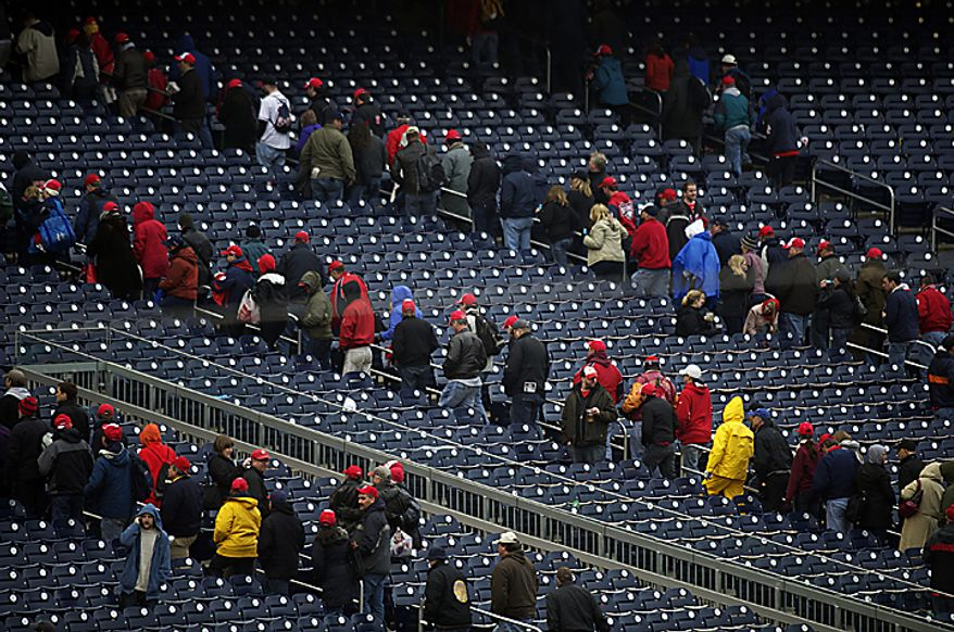Fans make their from their seats following the Washington Nationals' 2-0 loss to the Atlanta Braves on Opening Day at Nationals Park in Washington, D.C., Thursday, March 31, 2011. (Rod Lamkey Jr/The Washington Times)