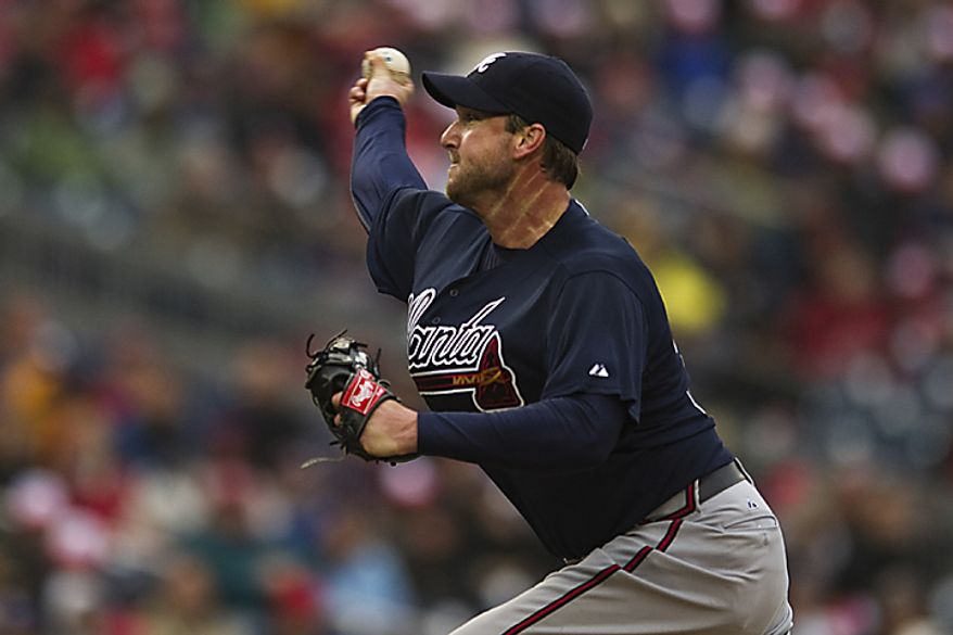 Braves starting pitcher Derek Lowe delivers a pitch during the third inning of the opening day game against the Washington Nationals at Nationals Park, in Washington, D.C., Thursday, March 31, 2011.  Lowe got the win for the Braves. (Drew Angerer/The Washington Times)