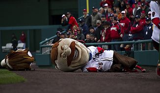 ** FILE ** Once again, Teddy the presidential mascot failed to win the mascot race during the opening day game against the Atlanta Braves at Nationals Park, in Washington, D.C., Thursday, March 31, 2011. (Drew Angerer/The Washington Times)