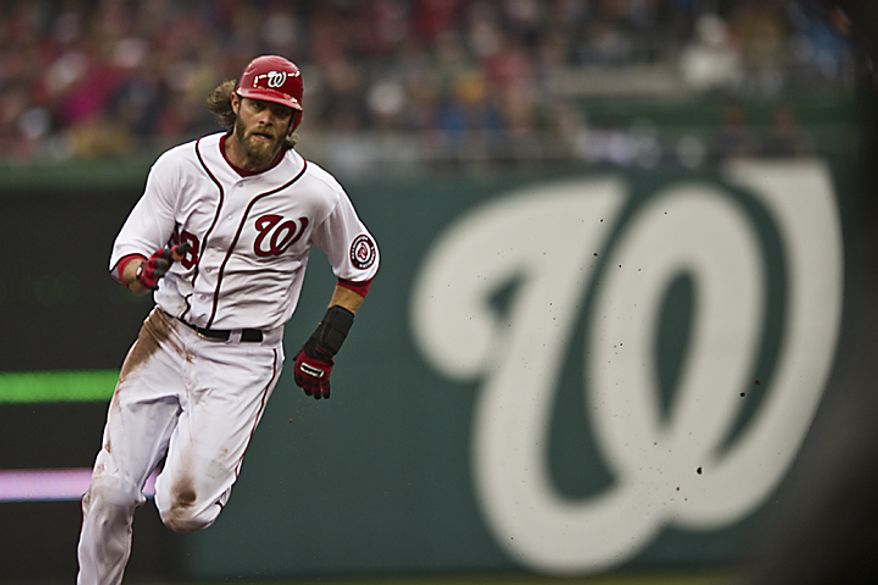 Jayson Werth rounds second and heads for third on a Ryan Zimmerman single during the first inning of the opening day game against the Atlanta Braves at Nationals Park, in Washington, D.C., Thursday, March 31, 2011. (Drew Angerer/The Washington Times)