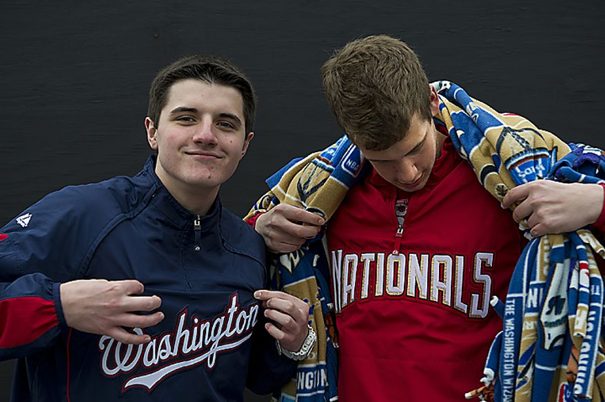 Robbie Thomas, left, and Alex Boyd, both 16 from Stafford, Va., took off school Thursday, March 31, 2011 to come to opening day at Nationals Park in Washington, D.C. (Barbara L. Salisbury/The Washington Times)