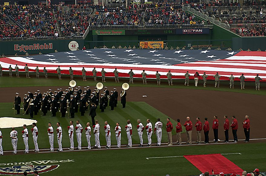 The American flag is brought out on the field as the Washington Nationals host the Atlanta Braves on Opening Day at Nationals Park in Washington, D.C., Thursday, March 31, 2011. (Rod Lamkey Jr/The Washington Times)