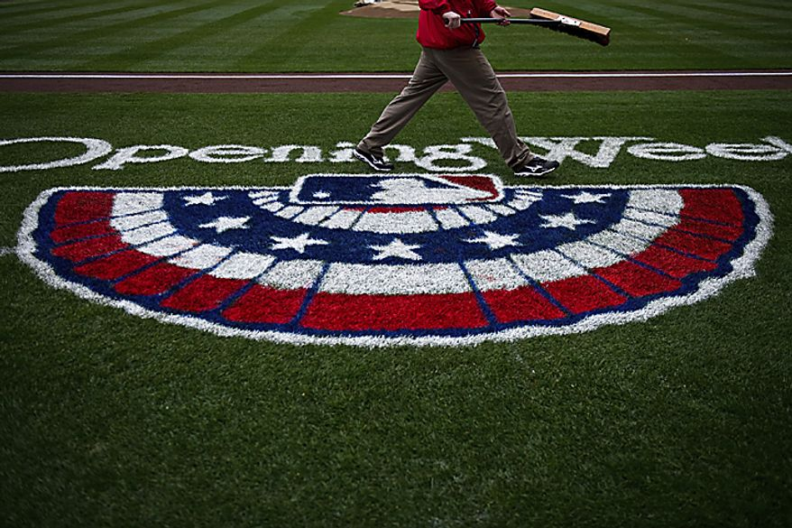 The Nationals grounds crew touch up the field prior to the opening day game against the Atlanta Braves at Nationals Park, in Washington, D.C., Thursday, March 31, 2011. (Drew Angerer/The Washington Times)