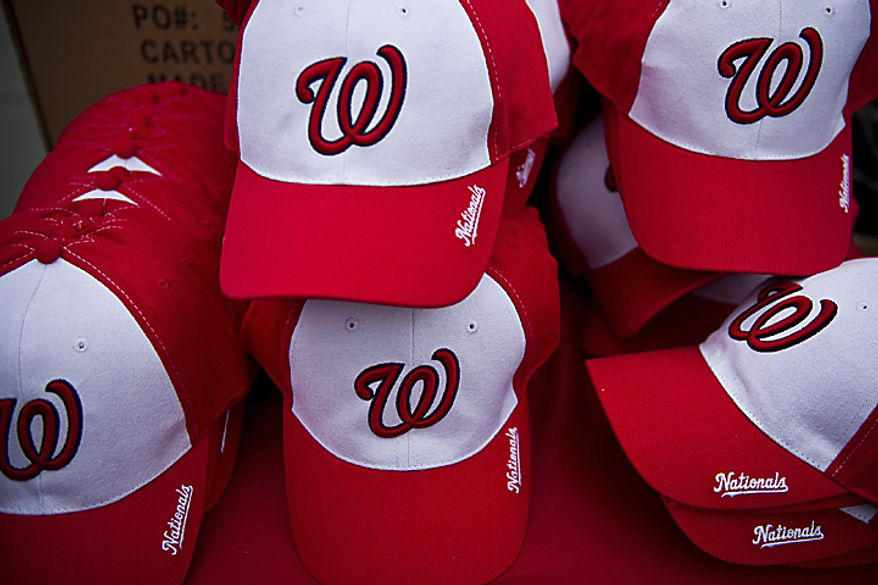 Complimentary Nationals hats were given to fans at Nationals Park prior to the opening day game against the Atlanta Braves, in Washington, D.C., Thursday, March 31, 2011. (Drew Angerer/The Washington Times)