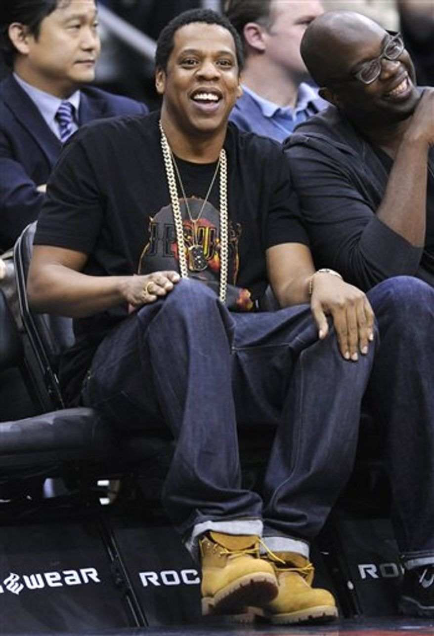FILE - In this March 11, 2011 file photo, recording artist Jay-Z watches the New Jersey Nets and the Los Angeles Clippers play an NBA basketball game in Newark, N.J. (AP Photo/Bill Kostroun, File)