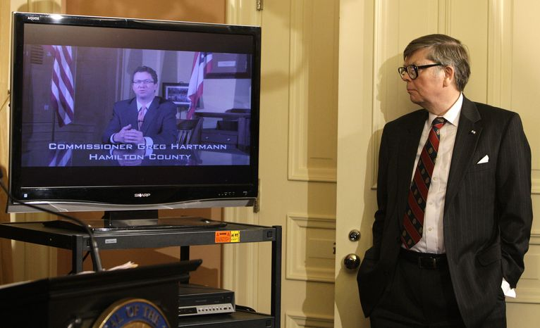 Ohio House Speaker William Batchelder, a Republican, watches a Senate Bill 5 video produced by the governor's office during a news conference on Wednesday, March 30, 2011, in Columbus, Ohio. (AP Photo/Jay LaPrete)